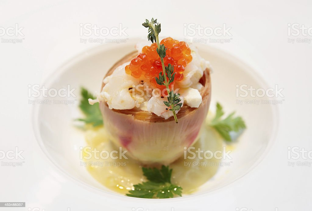 Gourmet appetizer with artichoke, seafood, and salmon roe stock photo