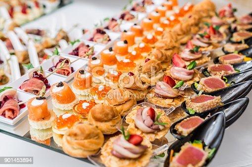 istock Gourmet appetizers: caviar, venison, tuna and salmon. 901453894