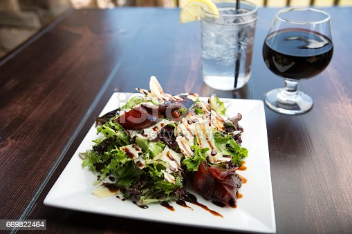 Delicious green salad topped with beets and balsamic vinegar