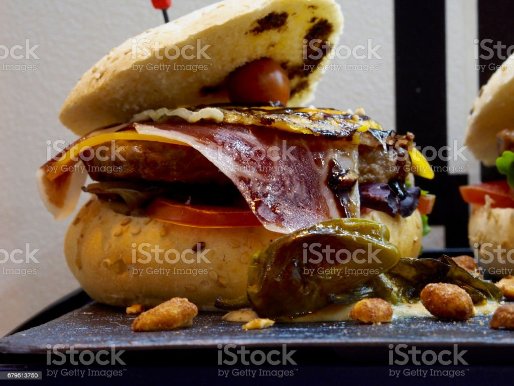 Gourmet burger with serrano ham royalty-free stock photo