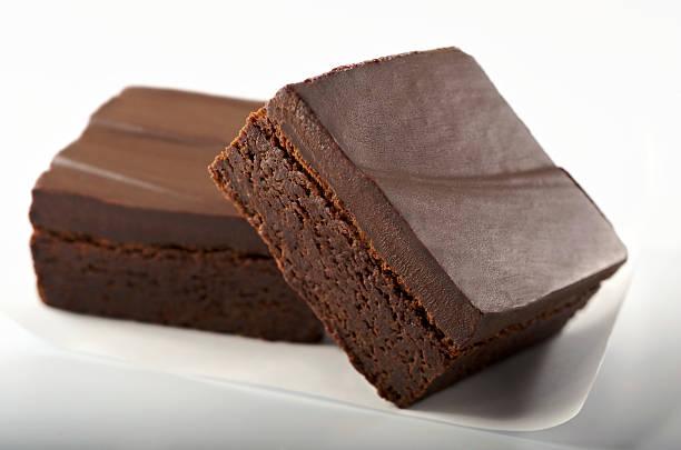 gourmet chocolate brownies on white - fudge stockfoto's en -beelden