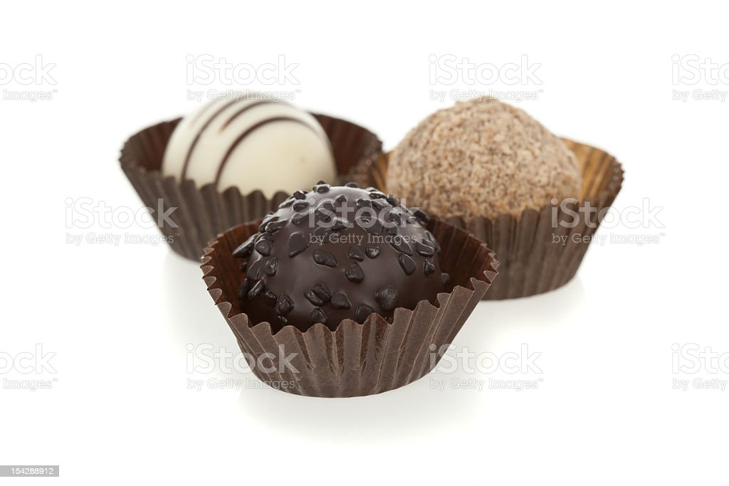 Gourmet chocolate truffles isolated on white royalty-free stock photo