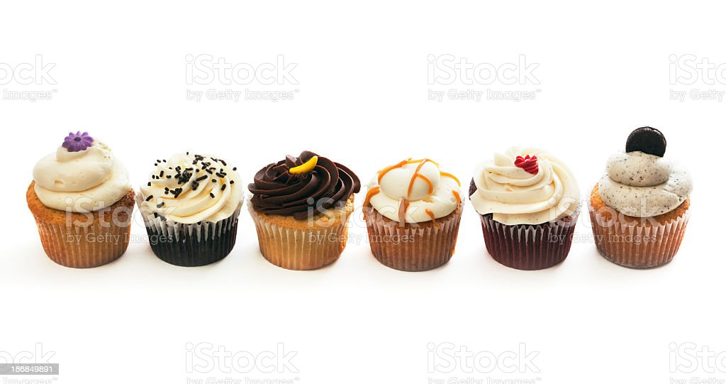 Gourmet Cupcakes Variety Selection Row, Sweet Cakes on White Background royalty-free stock photo