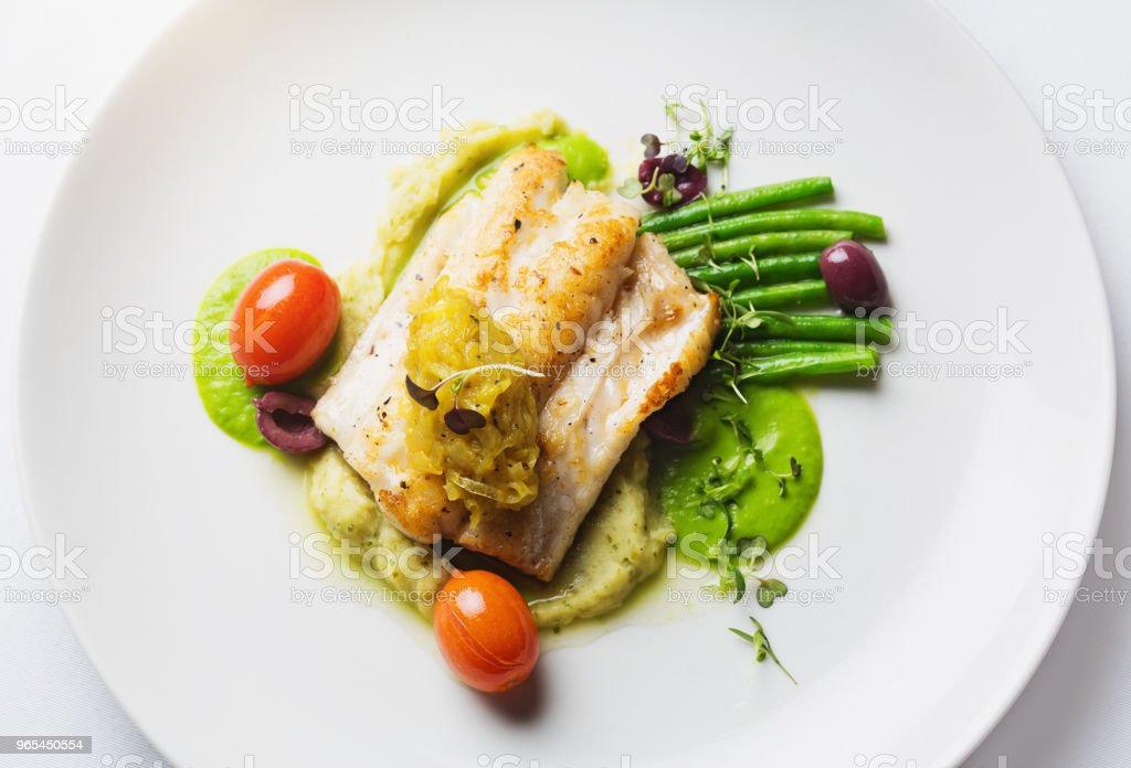 Gourmet dish of grilled fish with vegetables royalty-free stock photo