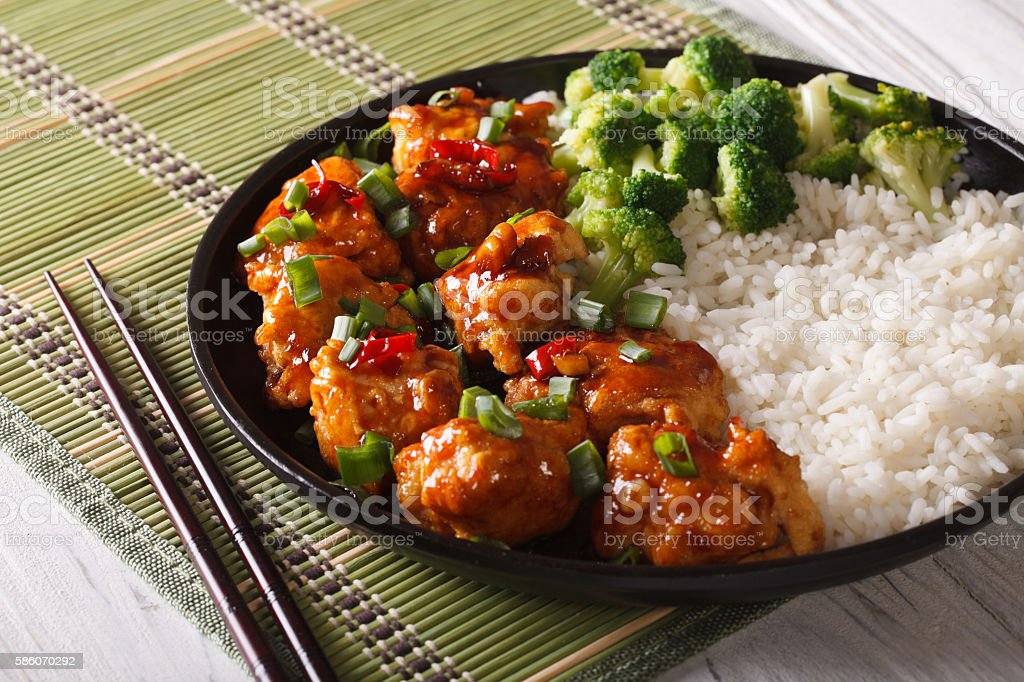 Gourmet Food: chickenTso's with rice, onions and broccoli closeup stock photo
