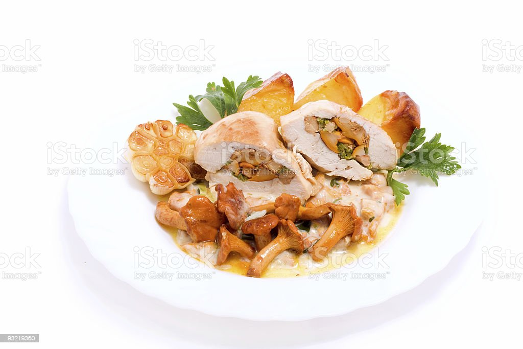 Gourmet food from chanterelles and chicken royalty-free stock photo