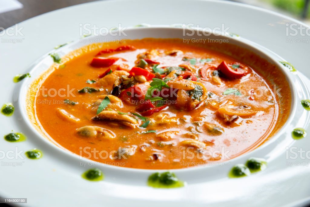 gourmet Greek dish with mussels in red sauce
