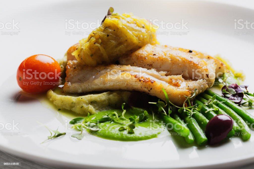 Gourmet grilled fish at luxury restaurant zbiór zdjęć royalty-free