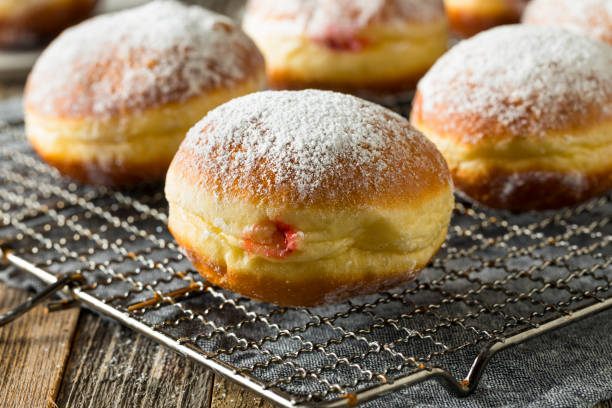 Gourmet Homemade Polish Paczki Donuts Gourmet Homemade Polish Paczki Donuts with Jelly Filling polish culture stock pictures, royalty-free photos & images