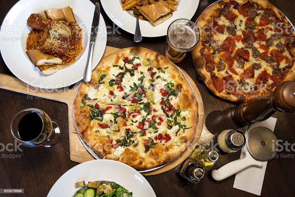 Gourmet Italian Food Pizza Pies On Restaurant Table