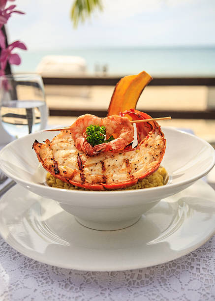 gourmet lobster and shrimp seafood by the sea - caribbean culture stock pictures, royalty-free photos & images