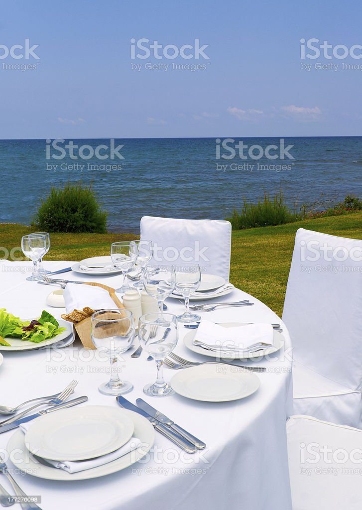 Gourmet lunch on the sea shore royalty-free stock photo