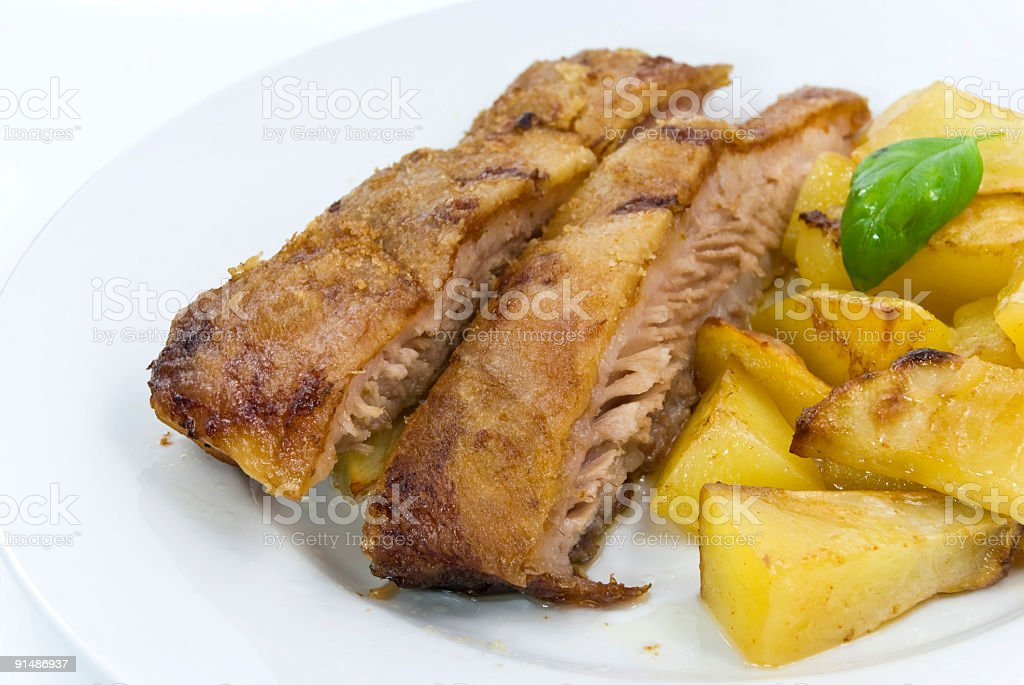 gourmet roast pork with fried potatoes and mint royalty-free stock photo