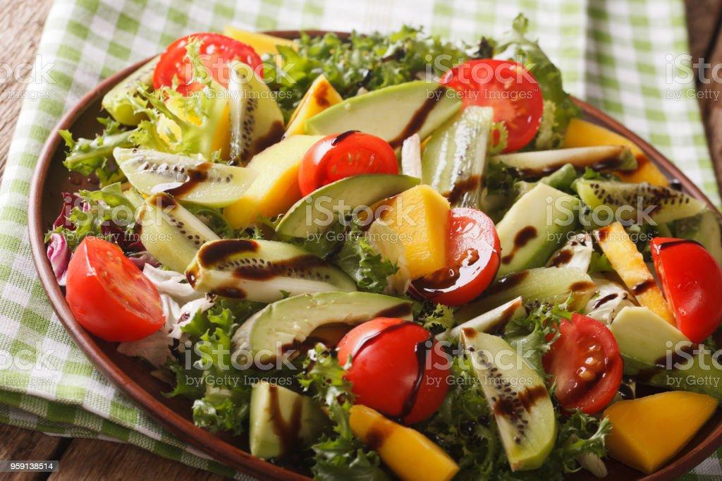 Gourmet Salad Of Mango Avocado Kiwi Lettuce Tomato Dressed With