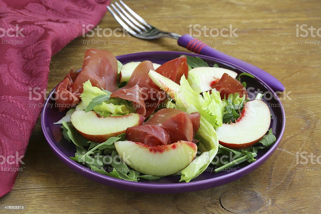 gourmet salad with peaches and bresaola (smoked beef) royalty-free stock photo