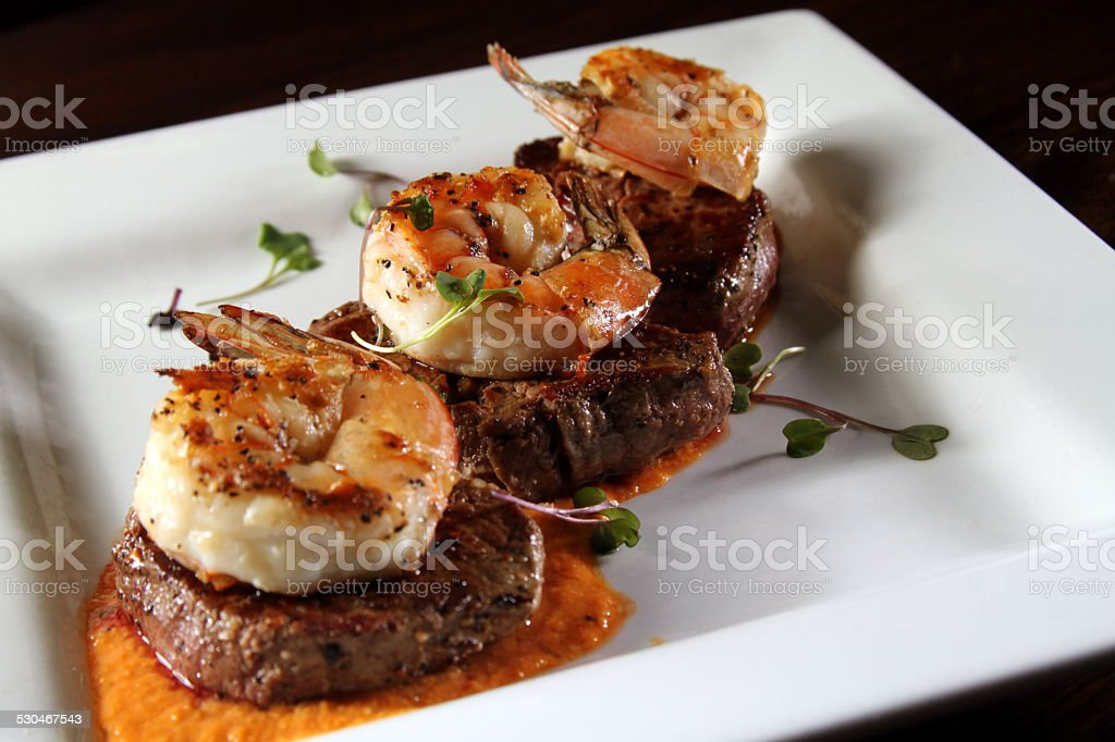 Gourmet surf and turf on a white plate stock photo