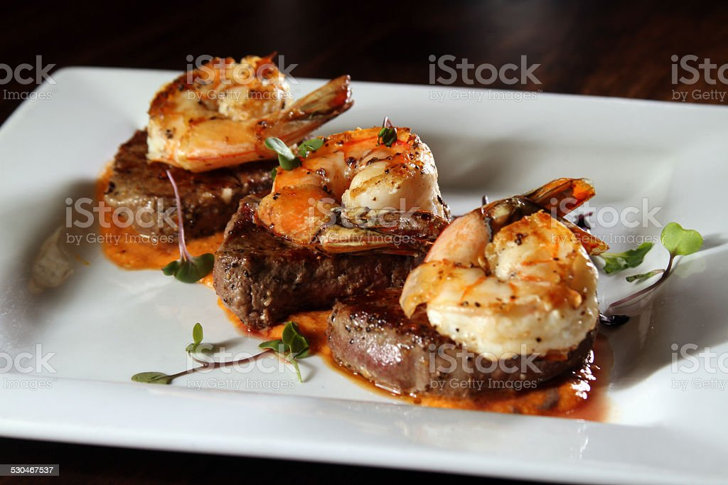 Gourmet surf and turf on white plate stock photo