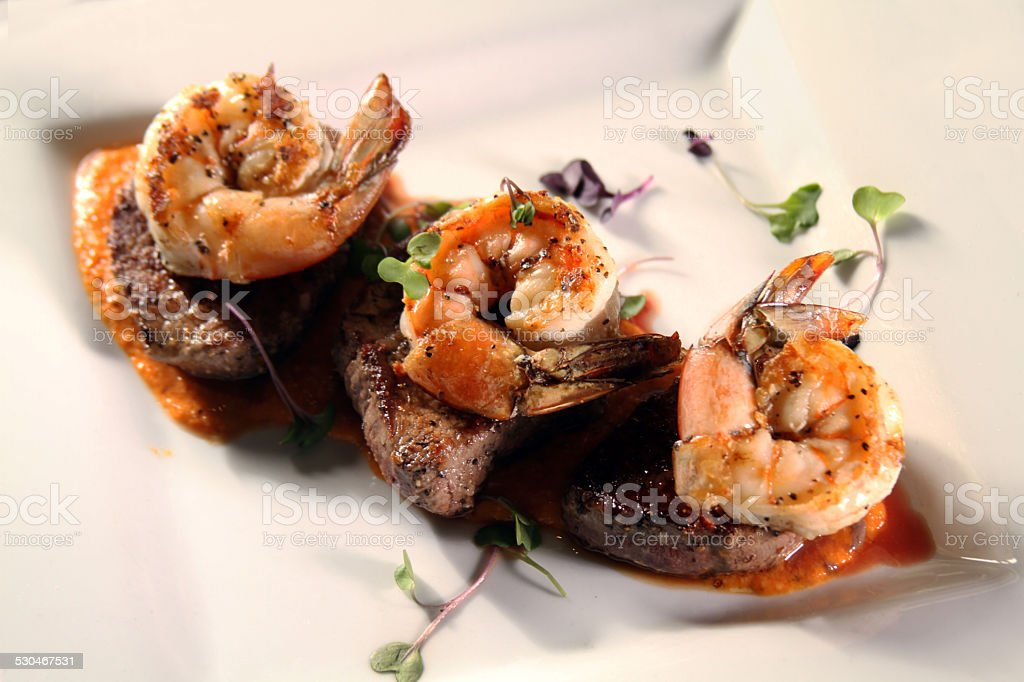 Gourmet surf and turf with white all around stock photo