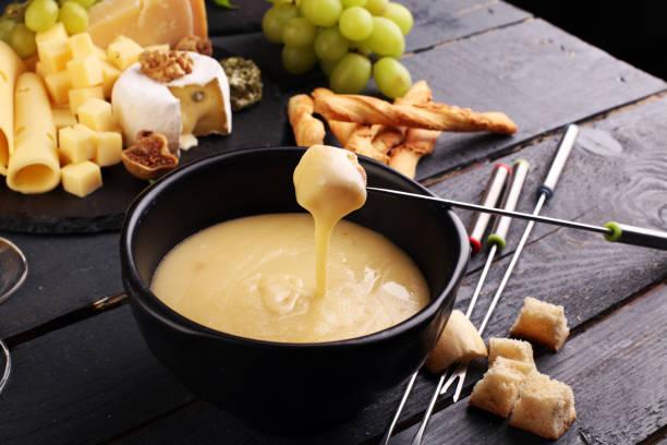 gourmet swiss fondue dinner - fondue stock-fotos und bilder