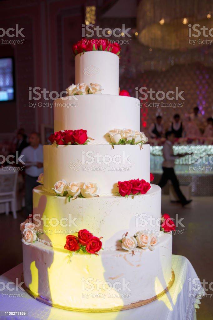 five-layer cake. Gourmet tiered wedding cake at wedding reception .5...