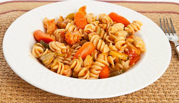 Gourmet Vegetable Pasta with Tomato Sauce stock photo