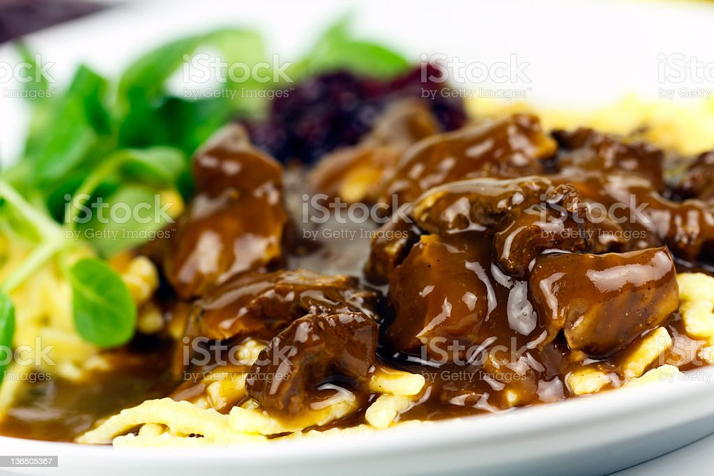 Gourmet Venison goulash with noodles and garnish stock photo