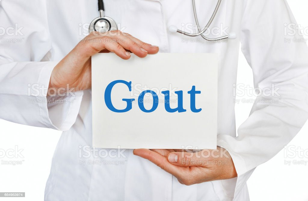 Gout card in hands of Medical Doctor stock photo