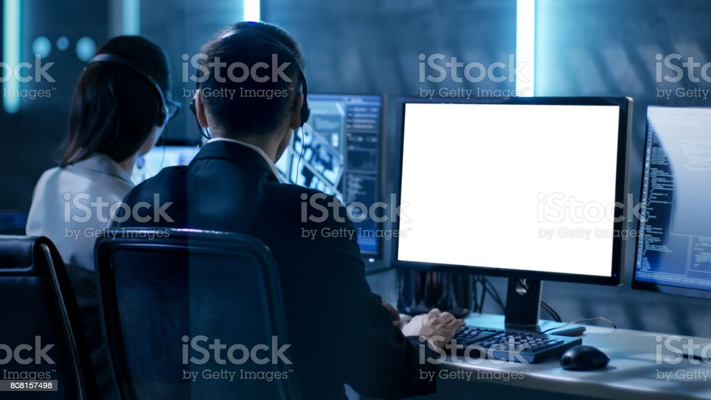 government agent is working in surveillance control center full of