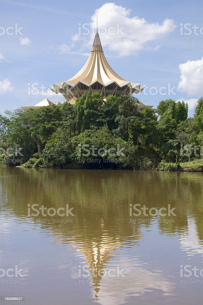 Government building mirrored in Sarawak River royalty-free stock photo