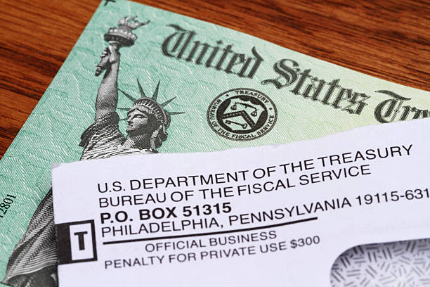 government check received in mail - disbursement stock pictures, royalty-free photos & images