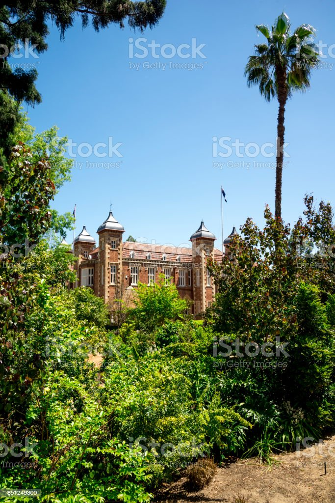 Government House hiding behind trees in Perth City centre, Western Australia stock photo