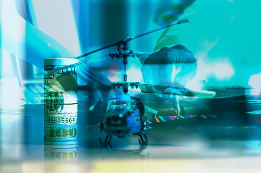 istock Government Military Defence Technology Abstract Background, Helicopter With Roll of US dollar Banknote, Concepts Of Modern Military Operation Cost. 1130379075