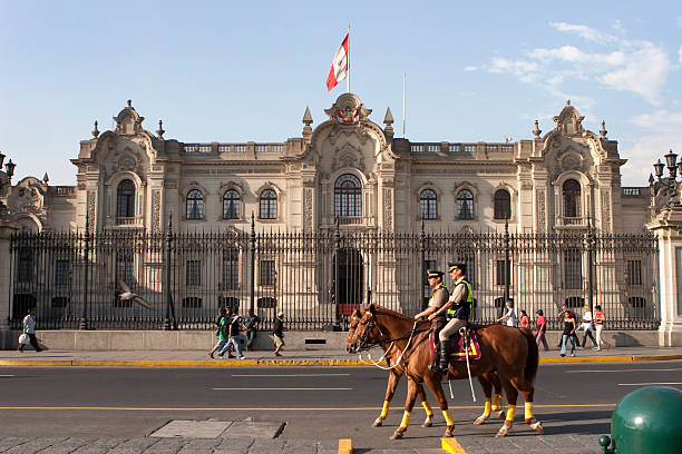 Government Palace pedestrians and Mounted Police in Lima Peru stock photo