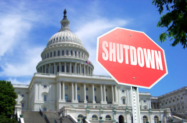 Government Shutdown concept: Stop sign in front of US Capital Building Concept stock photo