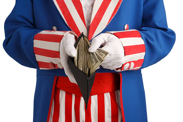 Government Spending A conceptual look at government spending. money to burn stock pictures, royalty-free photos & images