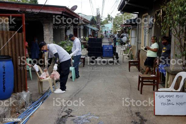 Government workers put relief goods on chairs in front of homes the picture id1220928880?b=1&k=6&m=1220928880&s=612x612&h=hzeve 6h6lq yf5qlxzaztefl4xqehbgaqlbcvvsrsk=