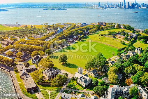 Fly over, view Governors Island National Monument near New York and Manhattan from a bird's eye view.