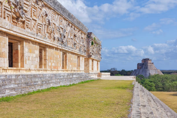 governor's palace and pyramid of the magician in maya ruin complex of uxmal - maya culture in mexico - uxmal stock photos and pictures