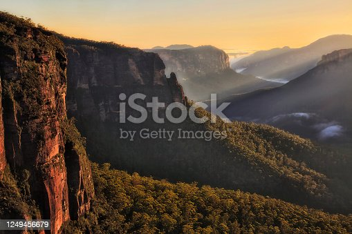 Sunrise over Blue Mountains in Austsralia - view over Grand Canyon penetrated by sun beams from Govetts leap lookout.