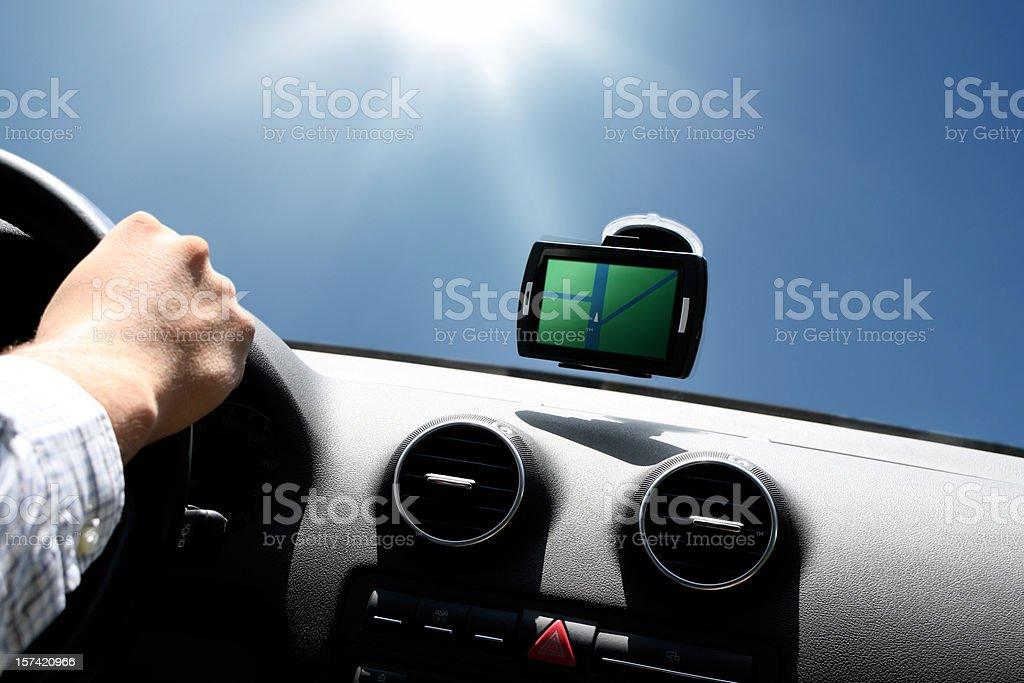 gps driving under sun stock photo