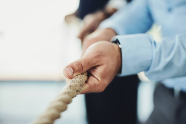Grab a hold of your goals and keep pulling them closer stock photo