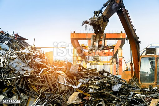 istock Grab crane works in waste recycling station 937865058