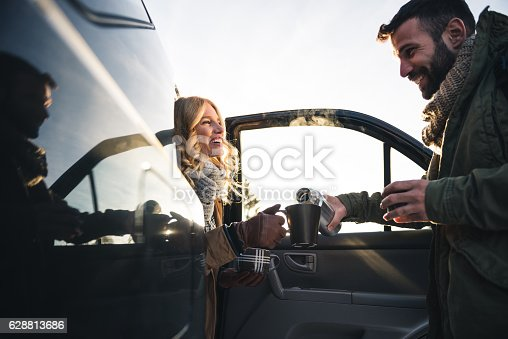 628541610istockphoto Grabbing a cup of coffee 628813686