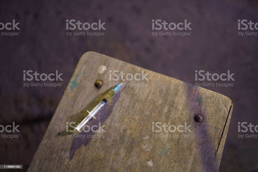Grabbing filled syringe on a table - Anxiety, depression and danger...