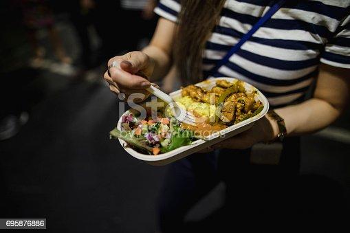 istock Grabbing Food at a Night Market 695876886