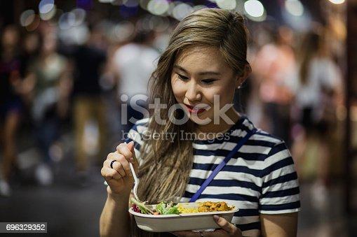 istock Grabbing Food at a Night Market 696329352