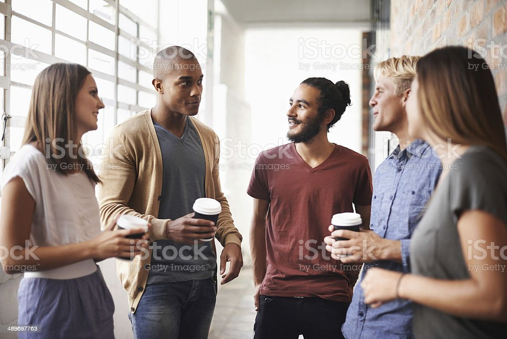 Grabbing some coffee with a few colleagues stock photo