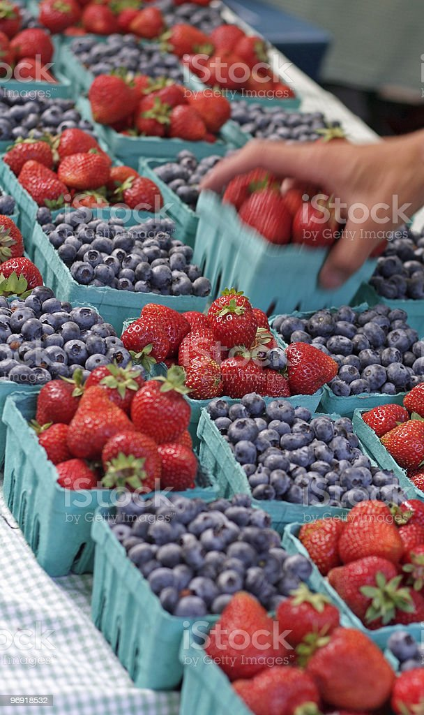 Grabbing the strawberries royalty-free stock photo