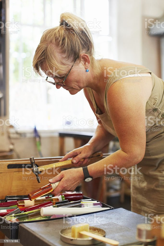 Grabbing the tools she needs royalty-free stock photo