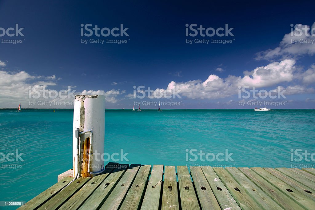 Grace Bay dock in Turks & Caicos royalty-free stock photo